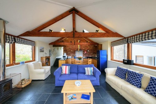 thatched-barn-sitting-room-and-kitchen-at-higher-wiscombe-2