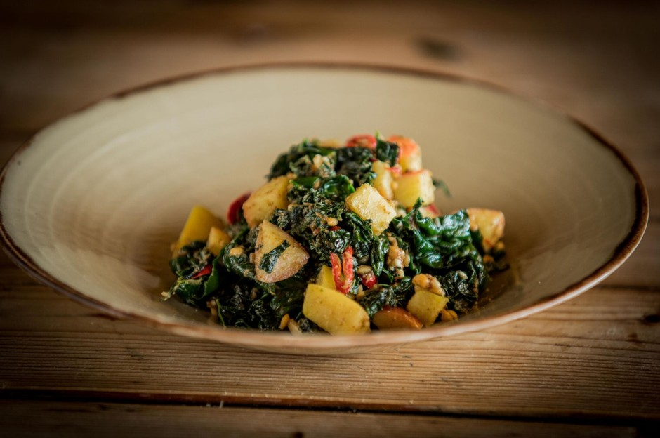 Kale  with  peaches, cashews, chilli and  English  ricotta