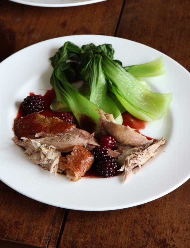 Duck, blackberries, greens