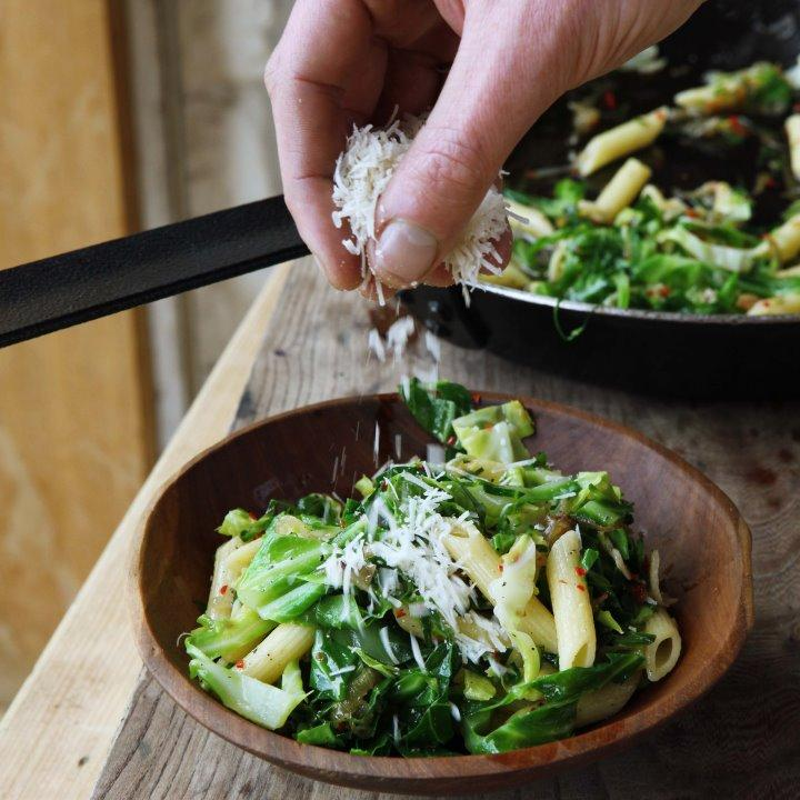 greens combined with a hearty portion of pasta and spiked with garlic ...