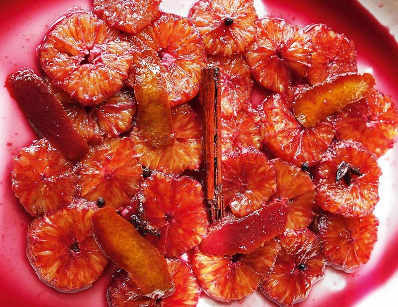 Oranges in mulled wine syrup